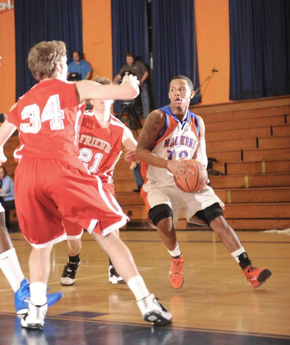 Malverne's Cory Alexander (13, right), looks to get