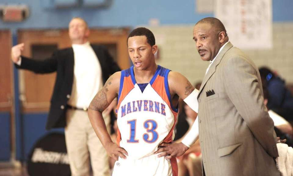 Malverne's Cory Alexander (13, left) goes to the