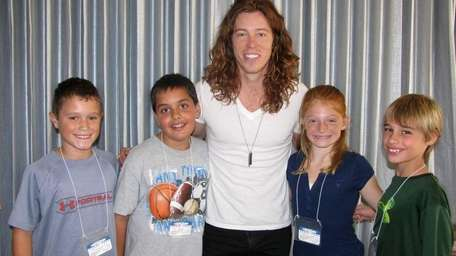 Snowboarder Shaun White with Kidsday reporters, from left,