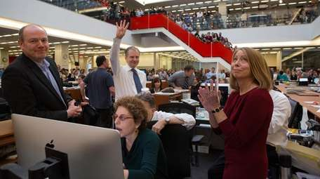 New York Times executive editor Jill Abramson, right,