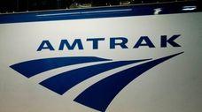 An Amtrak logo is seen on a train