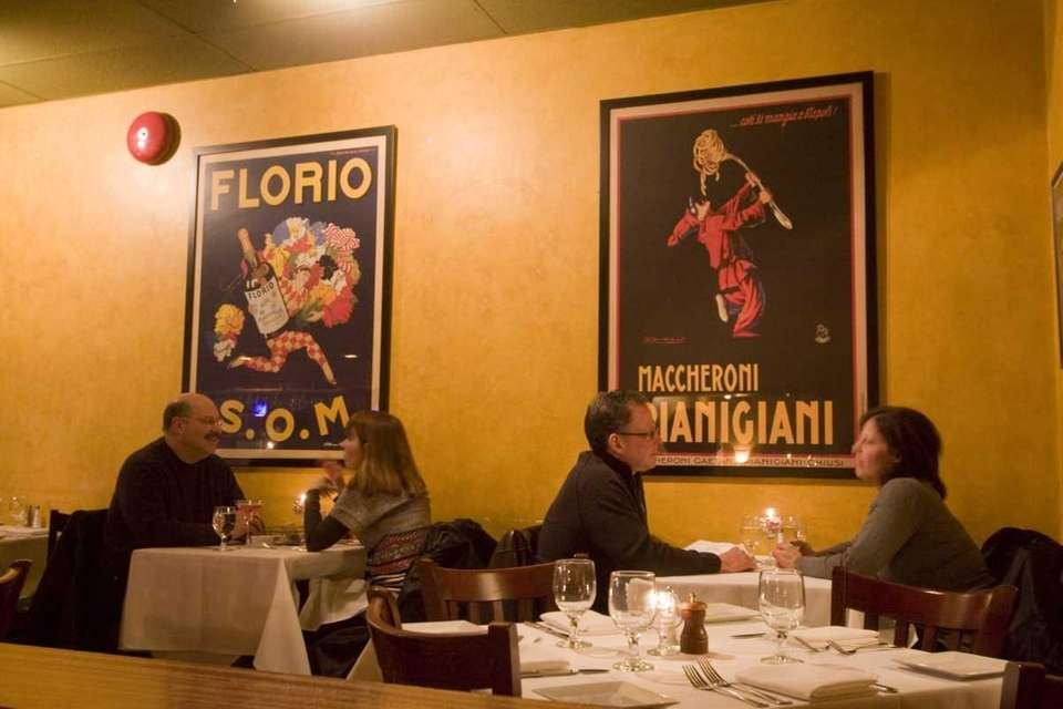 Italian posters line the walls at Pentimento, which