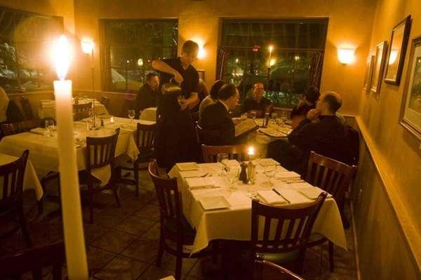 Diners peruse their menus at Pentimento in Stony