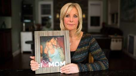 Sharon Richmond holds a photo of her son