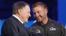 Patriots head coach Bill Belichick, left, and Rams