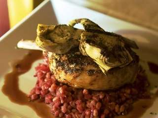 A grilled Duroc pork chop is one of