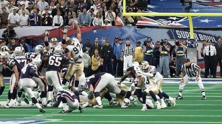The Patriots' kicker Adam Vinatieri kicks his game-winning