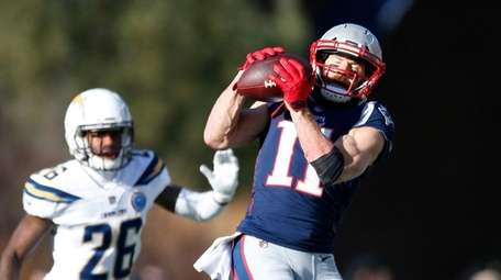 Patriots wide receiver Julian Edelman catches a pass