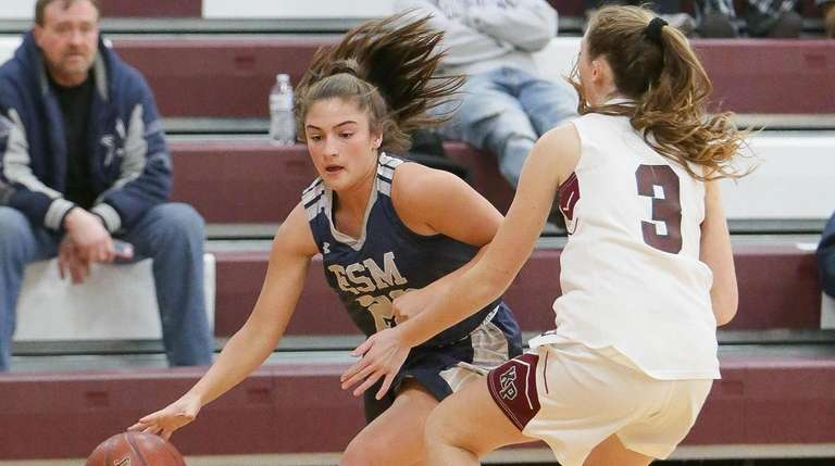 Eastport South Manor's Alexandra Giacolone (22) looks to
