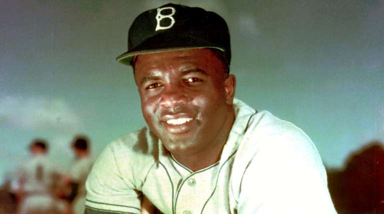 Brooklyn Dodgers baseball player Jackie Robinson poses in