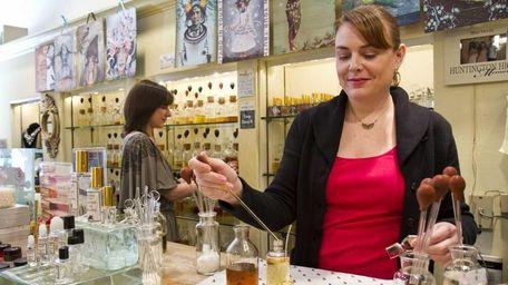 Alison Volkomer mixes a custom made fragrance at
