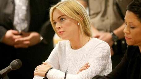 Lindsay Lohan appears in court during her arraignment