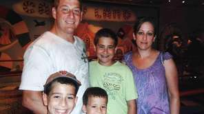 Michael Califano is seen with his sons Michael,