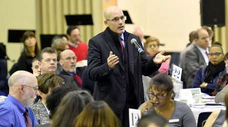Kenneth Bossert, superintendent of Elwood schools, asks a
