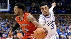 Duke's Tre Jones reaches for the ball while