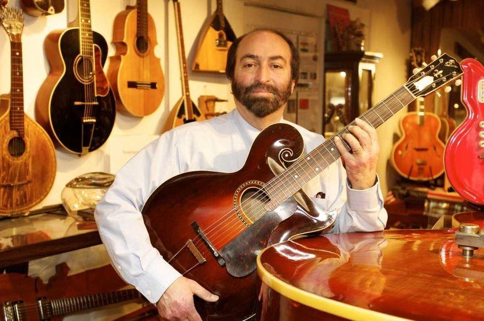 The American Guitar Museum's owner, Chris Ambadjes, poses