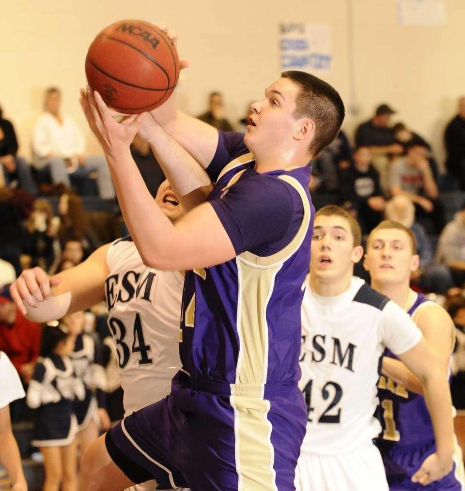 Islip's Andrew Oberg shoots past Eastport-South Manor's Sean
