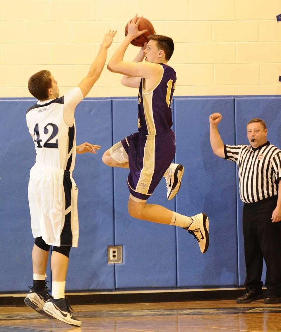 Islip's Tighe Oberg, right, attempts a jump shot
