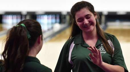 Paige Donovan of Seaford gets congratulated after a