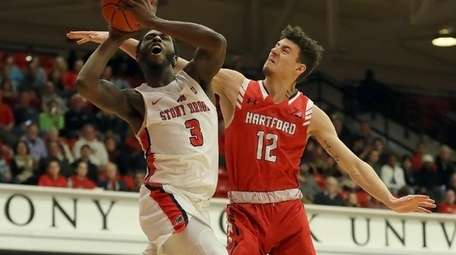 Stony Brook guard Elijah Olaniyi, left, who shot