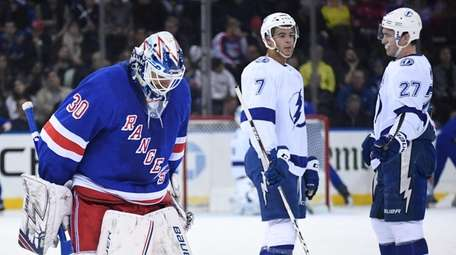 Rangers goaltender Henrik Lundqvist skates back onto the