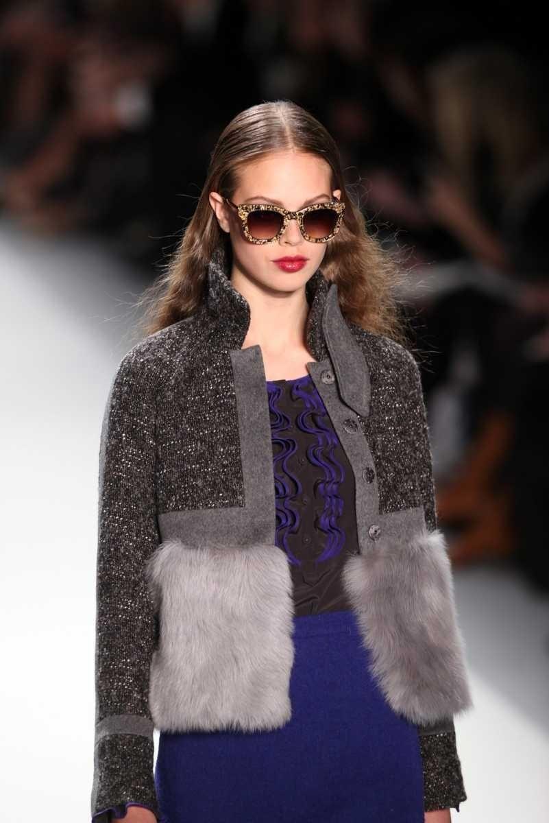 A model walks the runway at the Rebecca