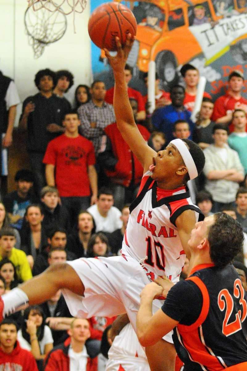 Floral Park guard #10 Lloyd Wheeler soars through