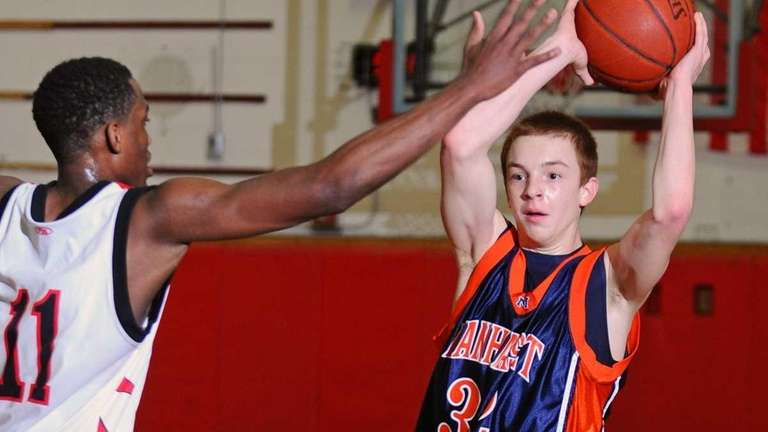 Manhasset guard #32 Dan Merola, right, looks to