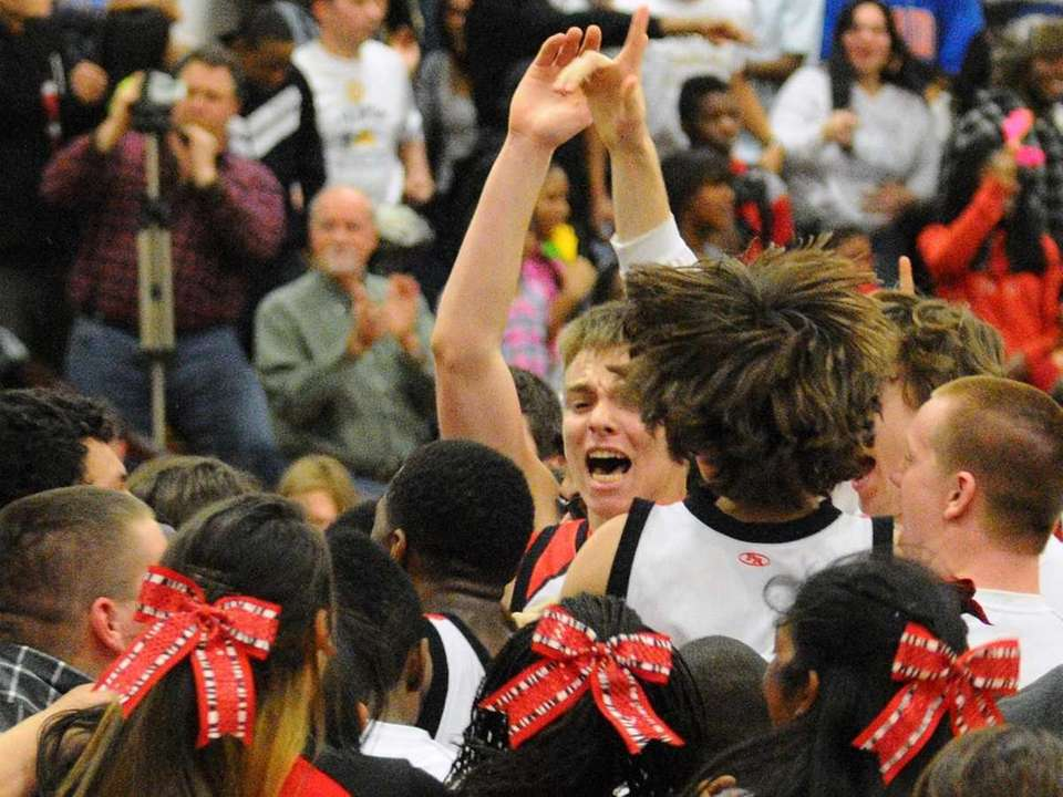 Fans storm the court after Floral Park High