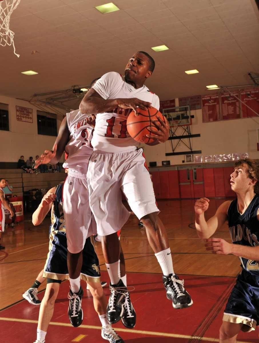 Amityville's #11 Richie Hobson pulls down a rebound