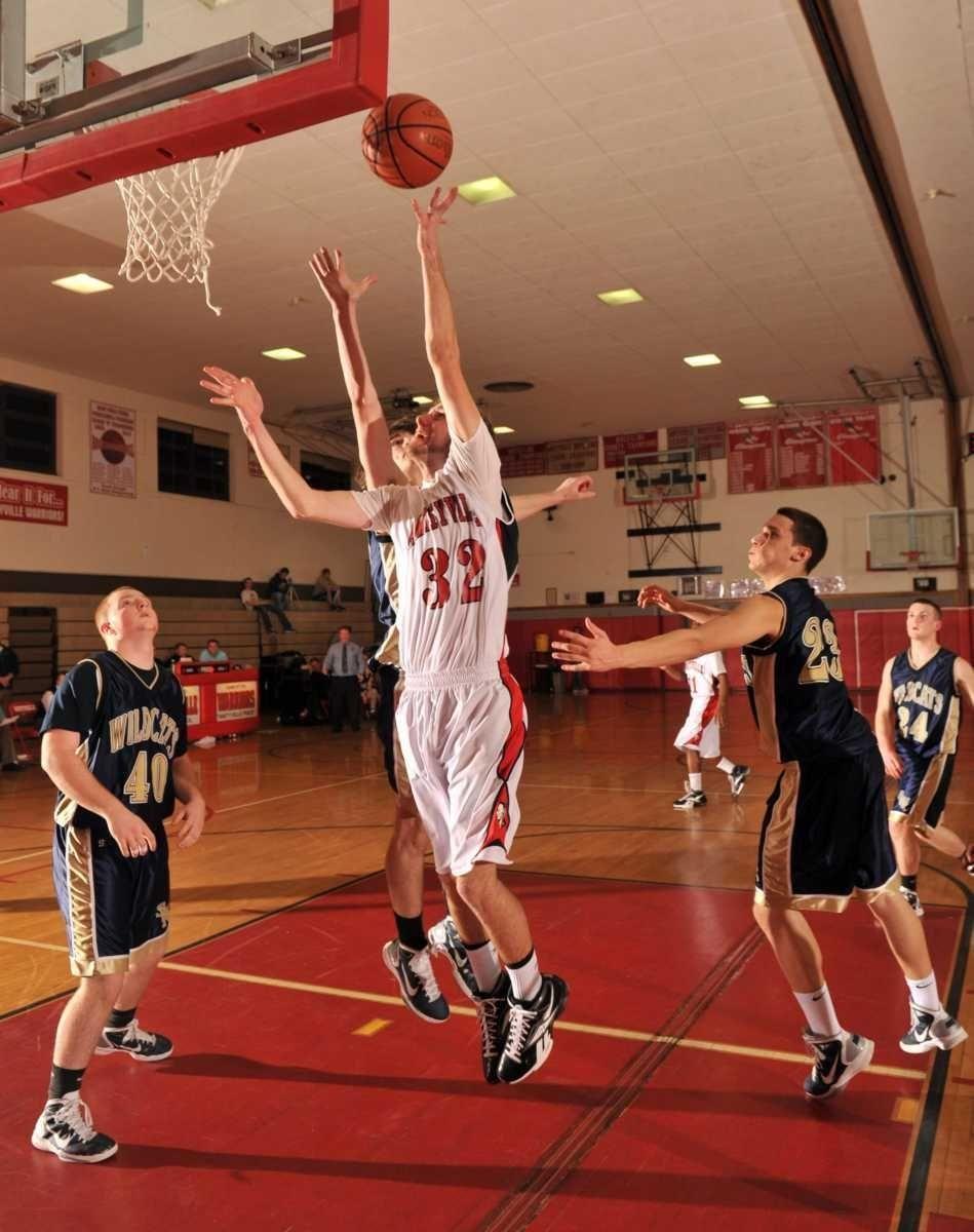 Amityville's #32 Brian Kretz puts up a basket