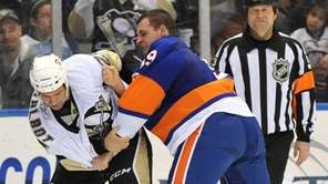 New York Islanders' Michael Haley fights with Pittsburgh