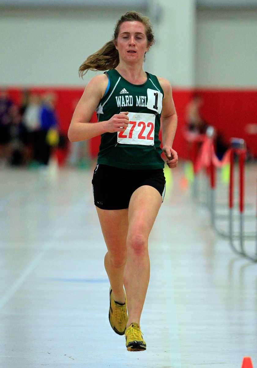 Mary Kate Anselmini of Ward Melville wins the