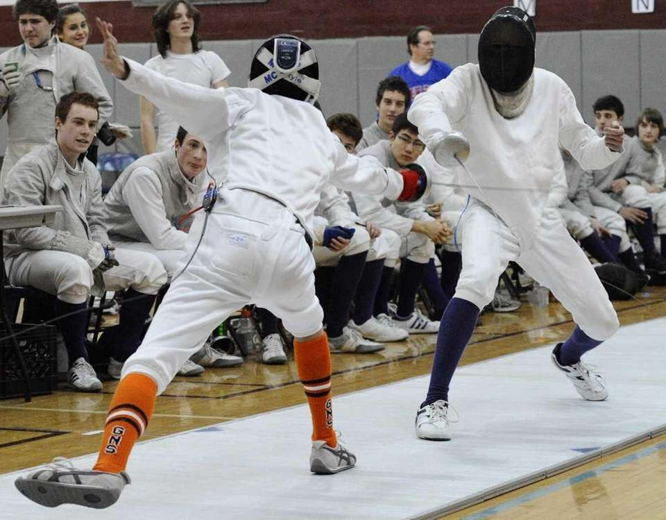 Oyster Bay's Andrew Stefano, right, fences in an