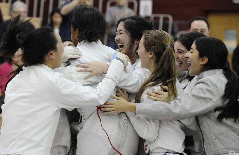 Great Neck South's girls fencing team celebrates winning