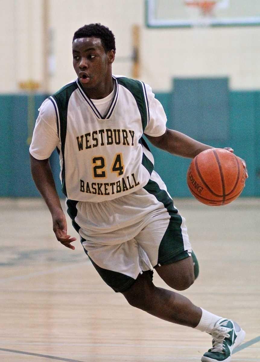 Westbury guard Tim Quashie #24 drives the lane