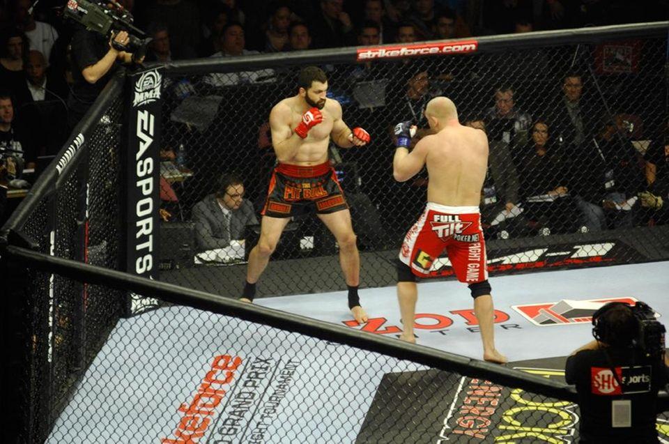 Andrei Arlovski, left, and Sergei Kharitinov fight in
