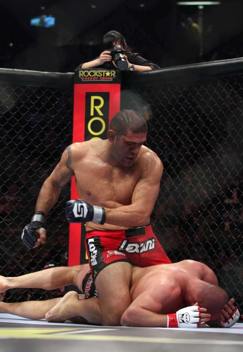 Antonio Silva, top, of Brazil, punches Fedor Emalianenko,