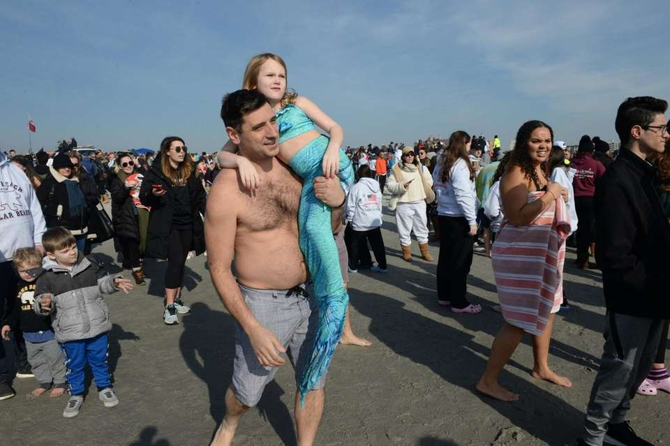 Minka Palazzolo, 6, heads to the water with