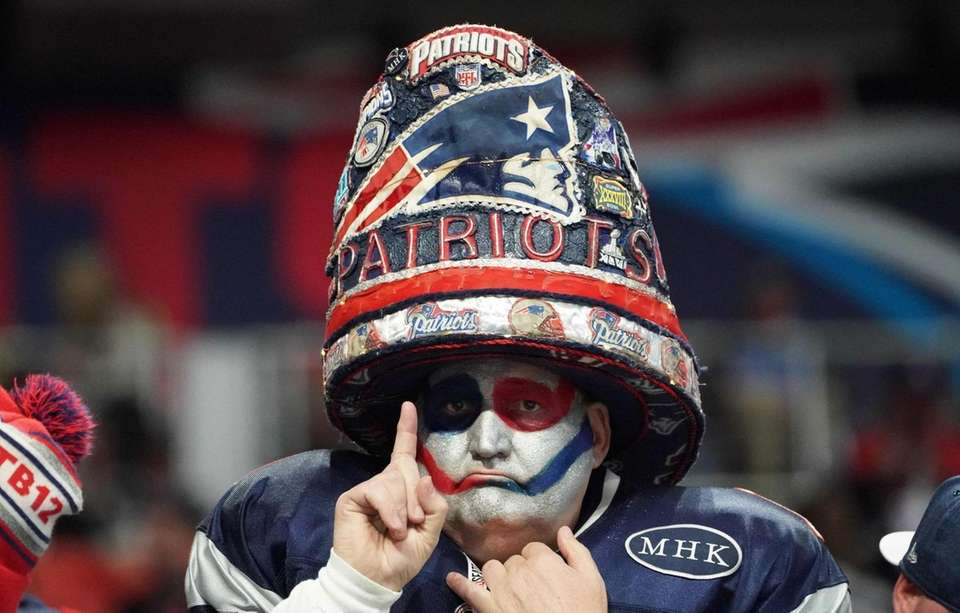 A New England Patriots' fan awaits the start