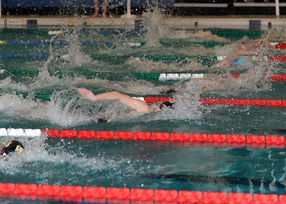 Bryan Galan of St Anthony's HS (lane 5)swims