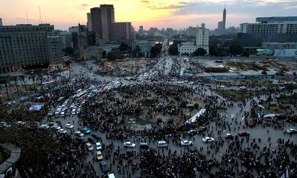 Traffic moves through Tahrir Square after the army