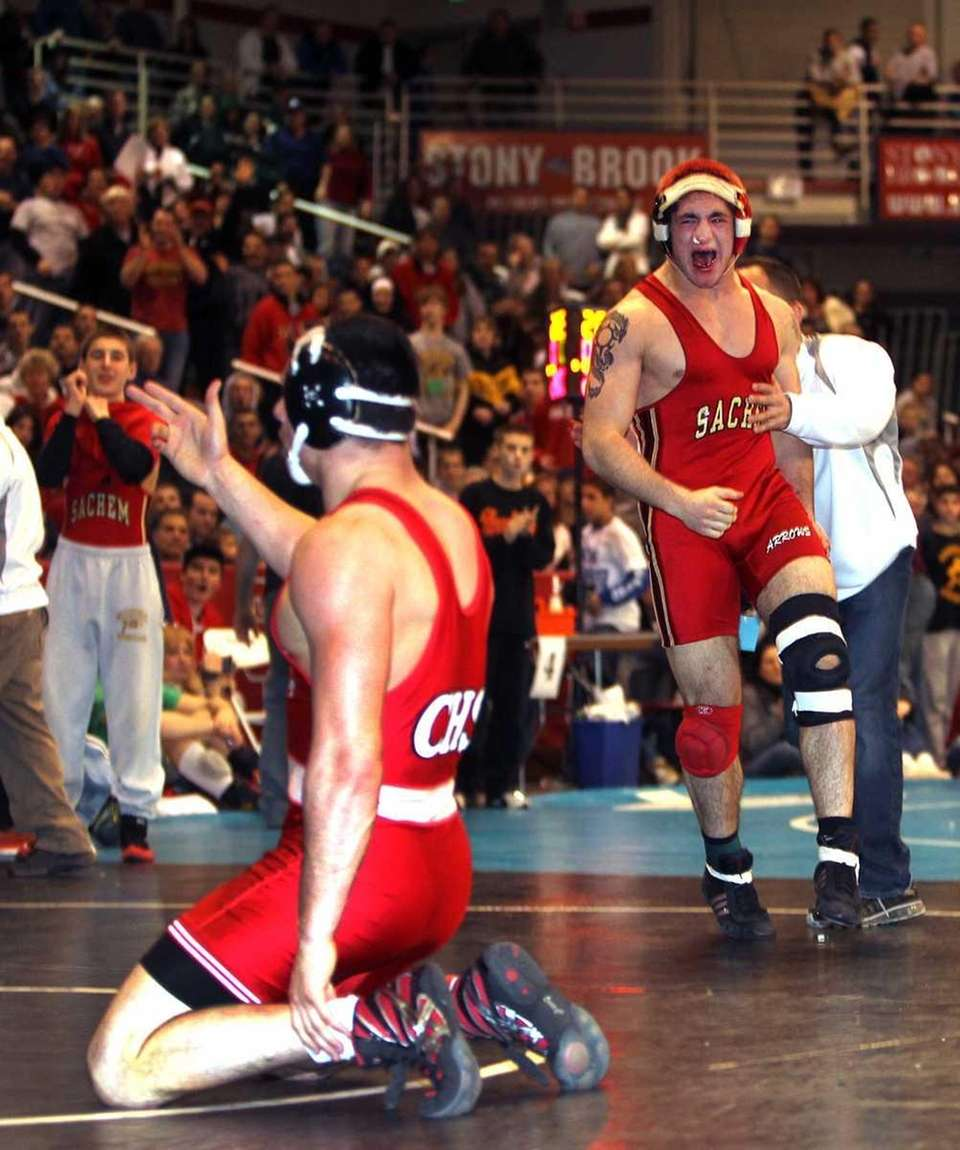 Sachem East's Frank Mercante celebrates his victory over