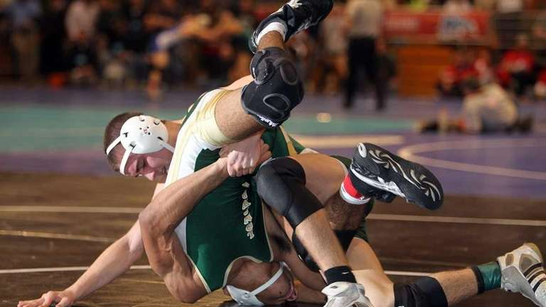 Westhampton's Conner Bass rolls Longwood's Andrew Stock to
