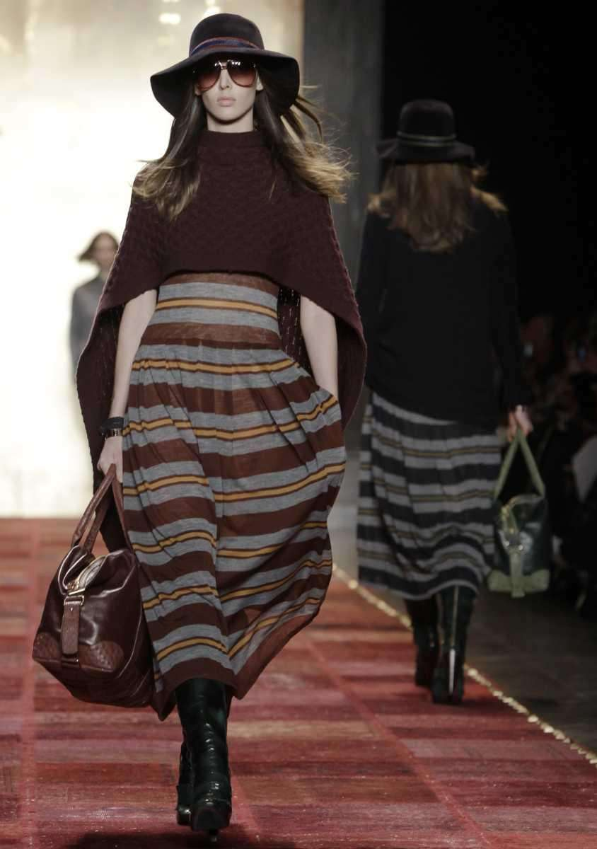 A model walks the runway at the Tommy