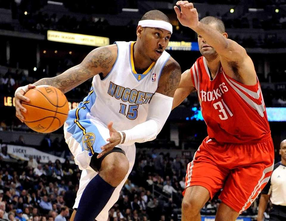 Denver Nuggets' Carmelo Anthony drives past Houston Rockets'