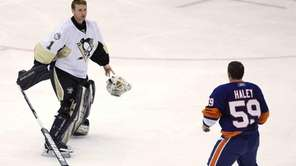 Pittsburgh Penguins goaltender Brent Johnson, left, drops his