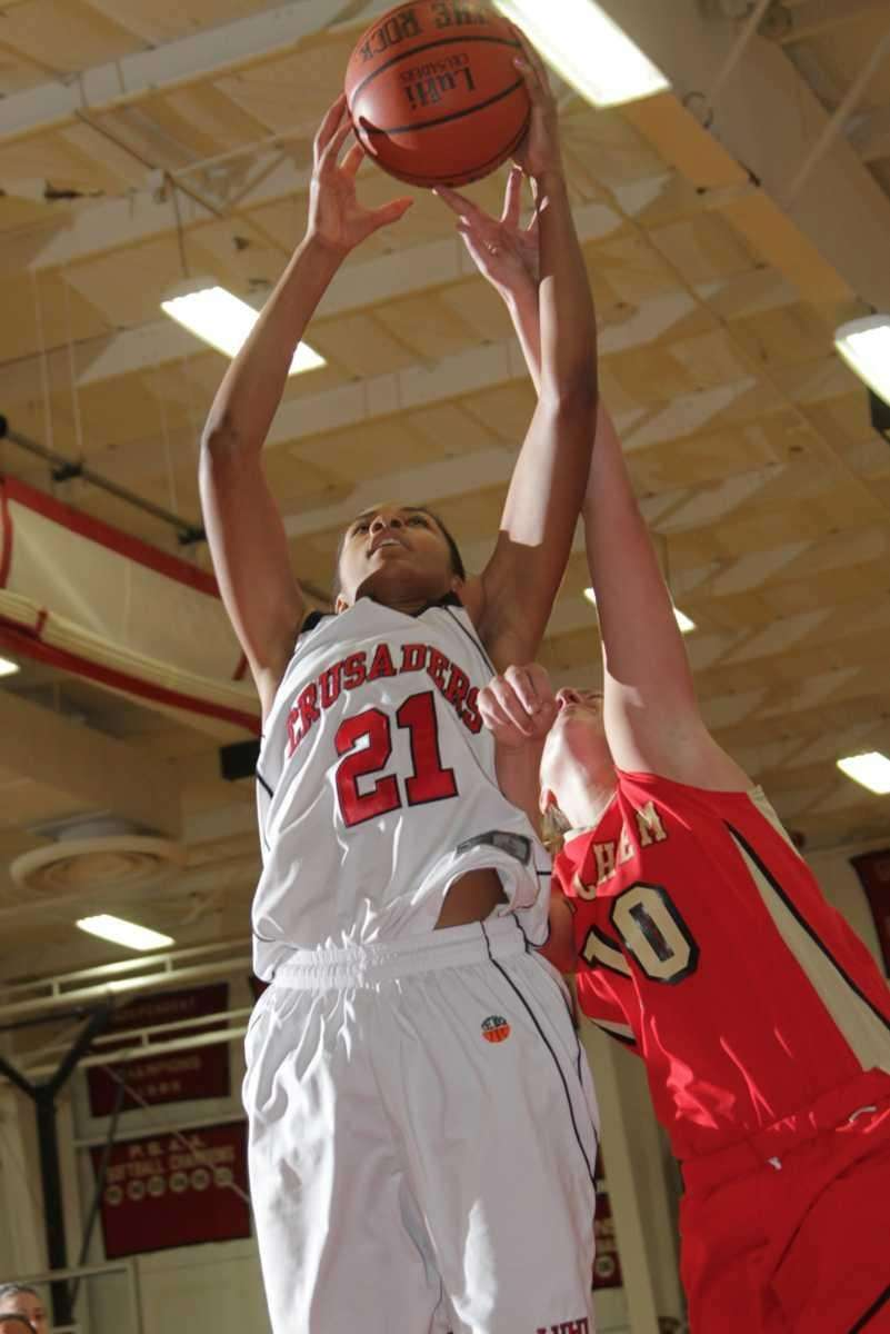Lutheran's Sade Gibbons drives to the net during