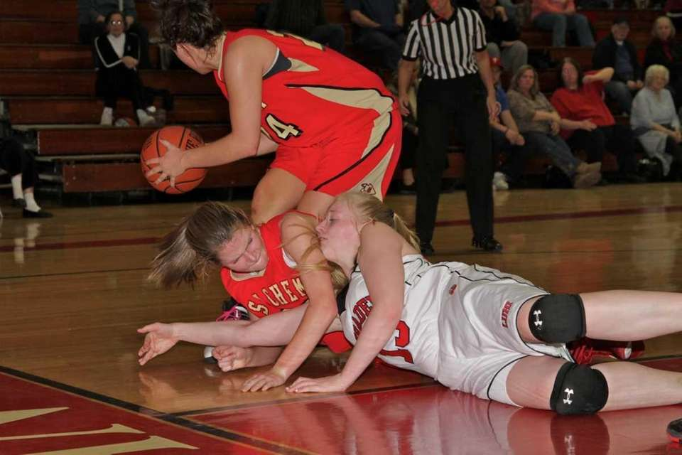 Lutheran's Sam Milhaven fight for the ball with
