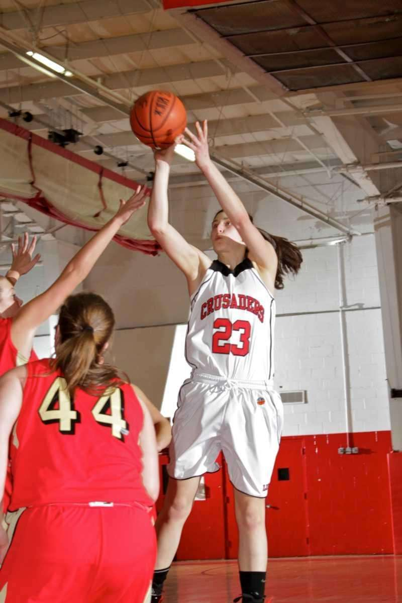 Lutheran's Yuni Sher drives to the basket during